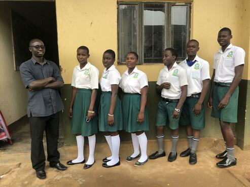 Mr. Ogwal with S4 computer class